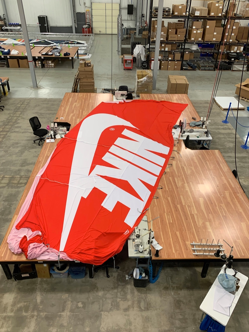 experiential retail structures Nike shoebox