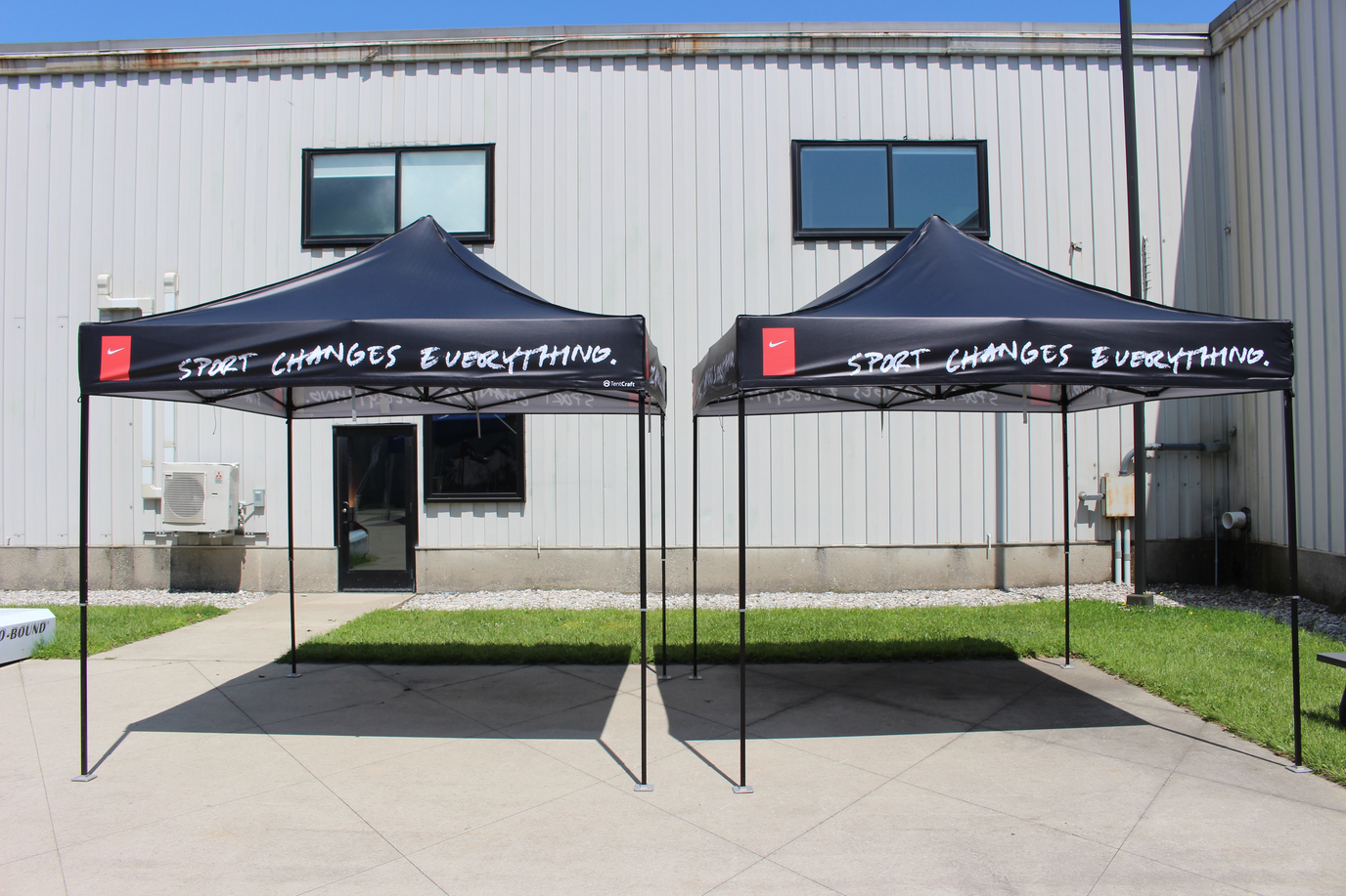 side by side black printed popup tents