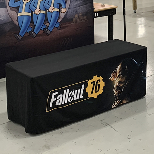 A black table cover with logo printed on front.