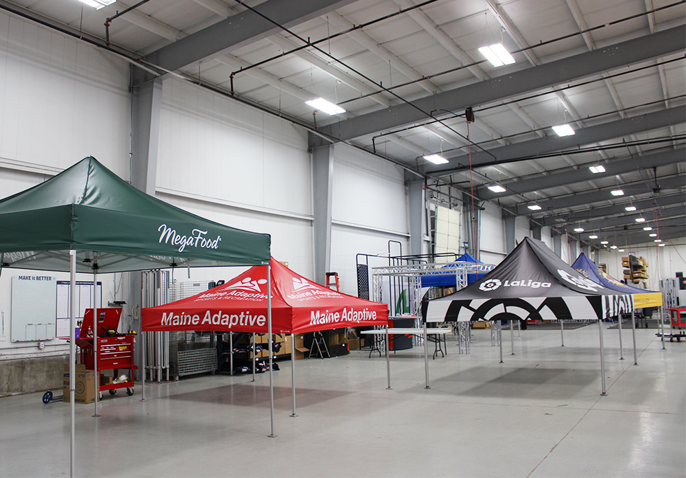Five MONARCHTENTS in the TentCraft warehouse awaiting quality assurance review.
