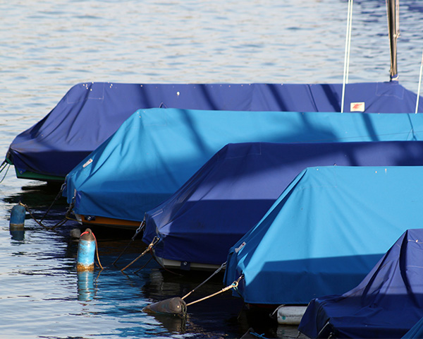 blue polyester tarp covering boats
