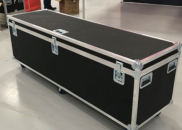 A hard transport case case with wheels.