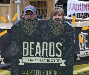 Two beer festival participants using custom printed A-frame stand at festival.