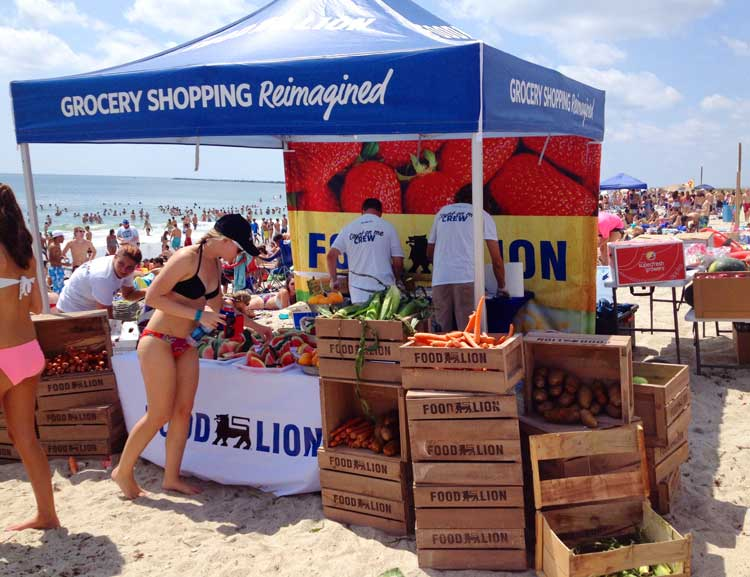 A 10x10 heavy-duty pop-up tent with UV printed full back wall used at beach for snack tent.